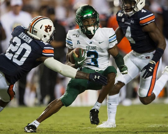 Tulane wide receiver Darnell Mooney (3) avoids a tackle at Jordan-Hare Stadium in Auburn, Ala., on Saturday, Sept. 7, 2019. Auburn leads Tulane 14-6 at halftime.