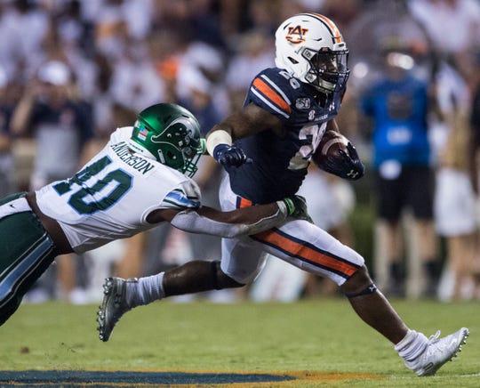 Auburn running back JaTarvious Whitlow (28) runs the ball at Jordan-Hare Stadium in Auburn, Ala., on Saturday, Sept. 7, 2019. Auburn defeated Tulane 24-6.