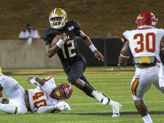 ASU's Kha'Darrius Davis (12) keeps his eyes up as he runs the ball during a quarterback keeper.