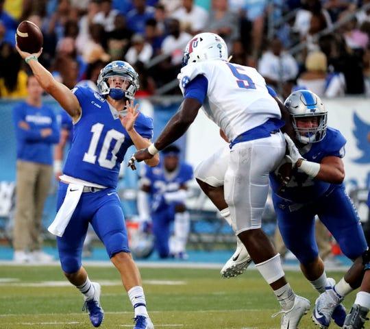 TSU defensive end Emmanuel Olenga (5) tries to get to MTSU quarterback Asher O'Hara during Saturday's game.