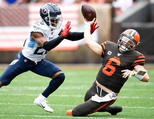 Tennessee Titans cornerback Logan Ryan (26) pressures Cleveland Browns quarterback Baker Mayfield (6) during the second quarter at FirstEnergy Stadium Sunday, Sept. 8, 2019 in Cleveland, Ohio.