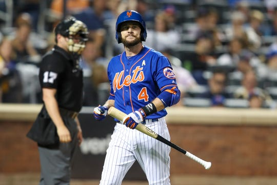 New York Mets' Jed Lowrie reacts after striking out during the fourth inning of a game against the Philadelphia Phillies, Saturday, Sept. 7, 2019, in New York. This was Lowrie's first game of the season with is new team.