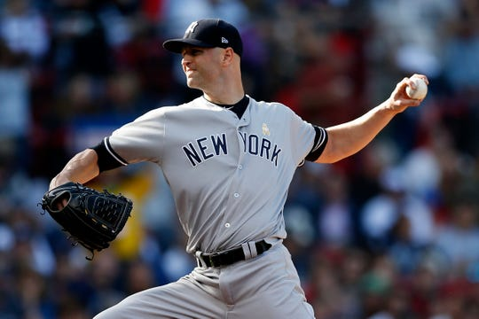 New York Yankees' J.A. Happ pitches during the second inning of a game against the Boston Red Sox in Boston, Saturday, Sept. 7, 2019.