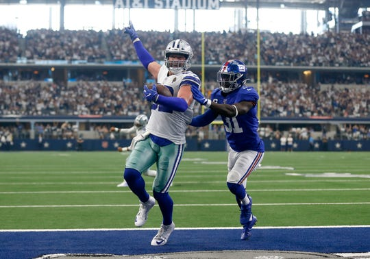 Dallas Cowboys tight end Jason Witten (82) celebrates catching a touchdown pass as New York Giants defensive back Michael Thomas (31) defends in the first half of a NFL football game in Arlington, Texas, Sunday, Sept. 8, 2019. (AP Photo/Ron Jenkins)