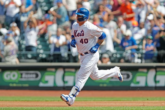 New York Mets' Wilson Ramos runs the bases after hitting a two-run home run during the first inning of a baseball game against the Philadelphia Phillies, Sunday, Sept. 8, 2019, in New York. (AP Photo/Kathy Willens)