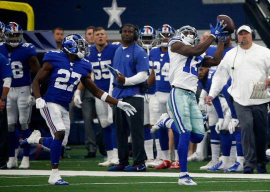New York Giants' Deandre Baker (27) defends as Dallas Cowboys wide receiver Michael Gallup (13) catches a pass in the first half of a NFL football game in Arlington, Texas, Sunday, Sept. 8, 2019. (AP Photo/Ron Jenkins)