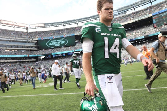 Sam Darnold of the NY Jets walks off the field after his team loses the 2019 season opener between the Buffalo Bills vs the New York Jets from MetLife Stadium in East Rutherford, NJ on September 8, 2019.