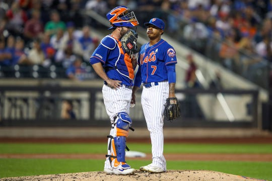 New York Mets starting pitcher Marcus Stroman (7) and catcher Tomas Nido have a mound conference during the fourth inning of a game against the Philadelphia Phillies, Saturday, Sept. 7, 2019, in New York.