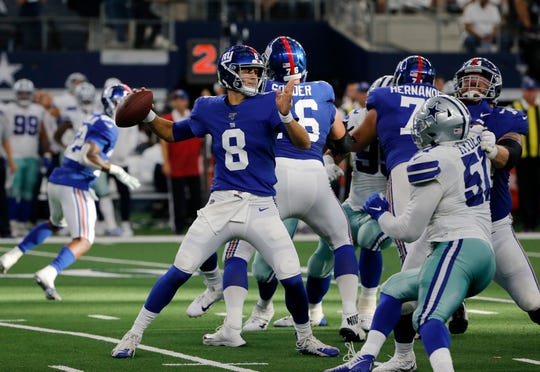 New York Giants quarterback Daniel Jones (8) throws a pass in the second half of a NFL football game against the Dallas Cowboys in Arlington, Texas, Sunday, Sept. 8, 2019. (AP Photo/Michael Ainsworth)