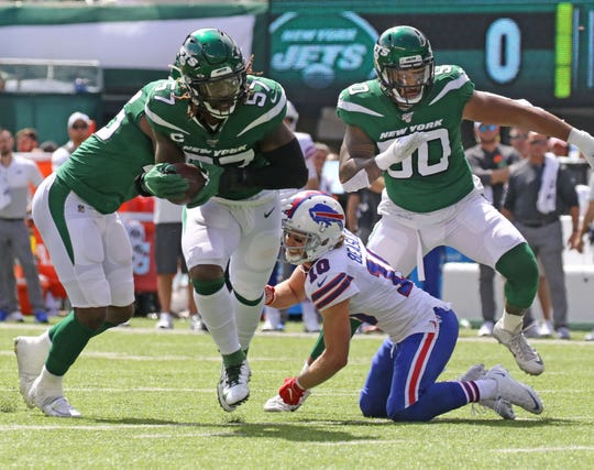 The ball bounces off of Cole Beasley of the Buffalo Bills and into the hands of C.J. Mosley of the NY Jets who takes it to the end zone for the only  touchdown of the first half.  This is the 2019 season opener between the Buffalo Bills vs the New York Jets from MetLife Stadium in East Rutherford, NJ on September 8, 2019.