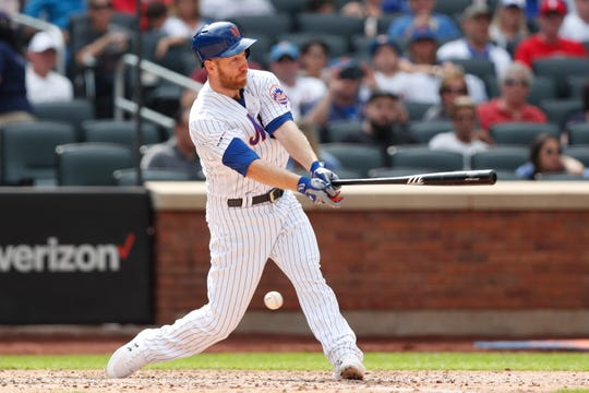 New York Mets pinch hitter Todd Frazier strikes out with bases loaded for the third out during the fifth inning of a baseball game against the Philadelphia Phillies, Sunday, Sept. 8, 2019, in New York. (AP Photo/Kathy Willens)