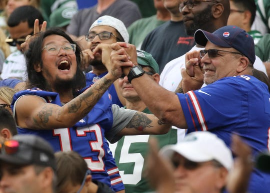 Buffalo fans celebrate the extra point that gave their team the lead in the fourth quarter in the 2019 season opener between the Buffalo Bills vs the New York Jets from MetLife Stadium in East Rutherford, NJ on September 8, 2019.