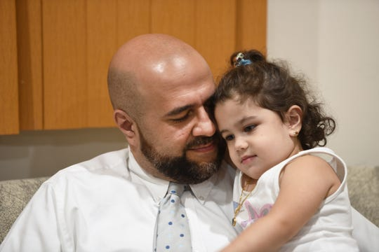 Mohamed Khairullah, mayor of Prospect Park, was traveling home from Turkey last month with his wife and kids when he said he was held and questioned for three hours bout his work and his travel. Khairullah is pictured with his daughter, Ahid.