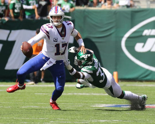 Josh Allen of the Buffalo Bills breaks the tackle of Jamal Adams of the NY Jets in the first half.  This is the 2019 season opener between the Buffalo Bills vs the New York Jets from MetLife Stadium in East Rutherford, NJ on September 8, 2019.