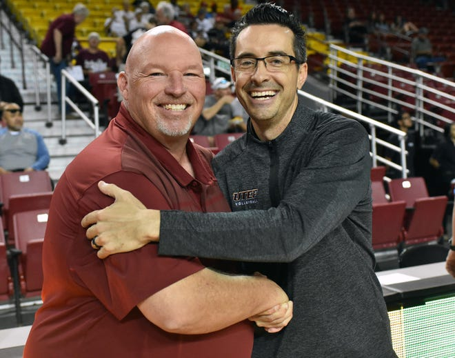 New Mexico State volleyball coach Mike Jordan (left) welcomes new UTEP Head coach and ex-Aggie assistant coach Ben Wallis back to the Pan American Center prior to Sunday's rivalry match at the Pan American Center.