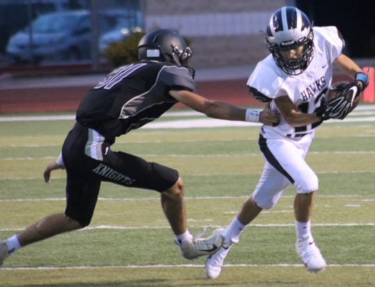 Oñate's Beto Garcia (81) tries to bring down Volcano Vista's Ivan Rodriguez on Saturday at the Field of Dreams.