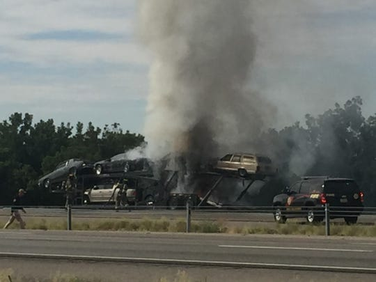 Authorities respond to a fire at Mile Marker 145 on Interstate 10 eastbound south of Las Cruces on Sunday, Sept. 8, 2019.