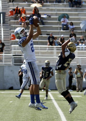 Carlsbad's Jaret Griffin makes a catch against Artisco Heritage on a 4th-and-long play to give the Cavemen a first down in 2019. Griffin looks to be one of Carlsbad's primary receivers in 2021 after working his way up from junior varsity last season.