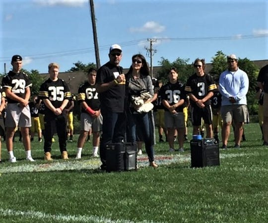 Kevin and Mary Poet express their appreciation at Saturday's jersey-retirement ceremony for their late son, Drew.