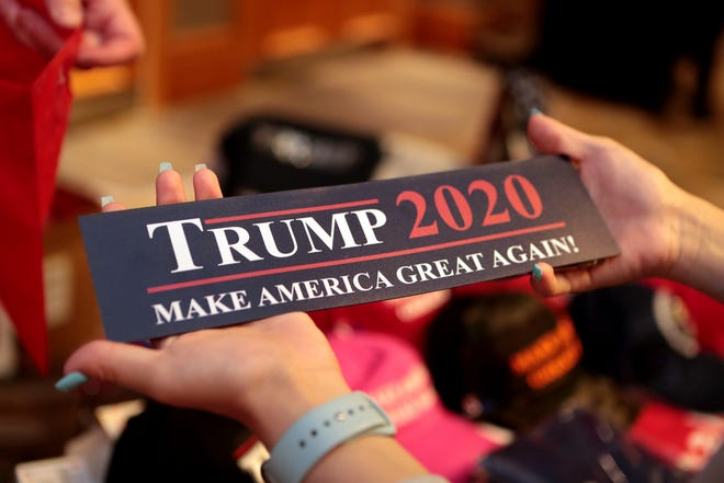Angel Chen, 18, of Riverside buys a Trump 2020 magnetic bumper sticker at the California GOP fall convention in Indian Wells, Calif., on Saturday, September 7, 2019.
