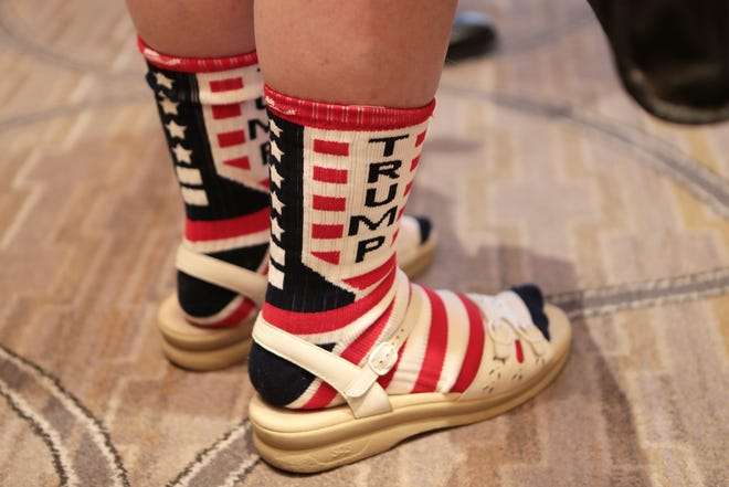 An attendee wears socks with Trump written on them during the California GOP fall convention in Indian Wells, Calif., on Saturday, September 7, 2019.
