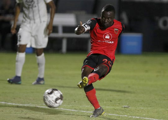 Phoenix Rising's Asante Solomon (20) gets a shot off against San Antonio's defense during the first half of their game at Casino Arizona Field in Scottsdale Sept 7, 2019. (Darryl Webb/For the Republic)
