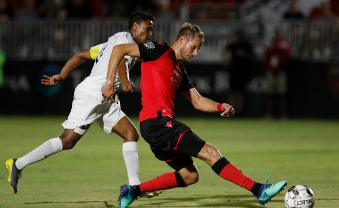 Phoenix Rising's Jahn Adam (9) gets a shot off against San Antonio's Pecka (8)  during the second half of their game at Casino Arizona Field in Scottsdale Sept 7, 2019. (Darryl Webb/For the Republic)