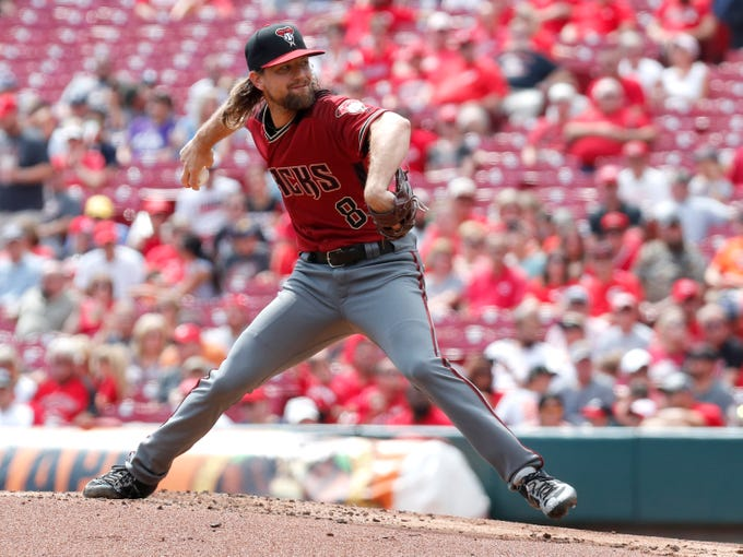 Sep 8, 2019; Cincinnati, OH, USA; Arizona Diamondbacks starting pitcher Mike Leake (8) throws against the Cincinnati Reds during the first inning at Great American Ball Park. Mandatory Credit: David Kohl-USA TODAY Sports
