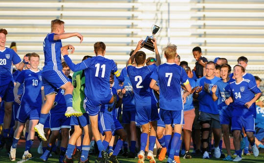 The Cedar Crest boys soccer team celebrates its 3-1 Ritter-Hoffman Cup win over Elco Saturday night.