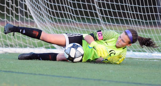 Cedar Crest Goal Keeper Courtney Wysokowski makes a save on an Elco penalty kick during the first half of action.