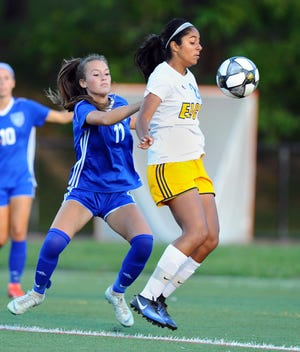 Elco's Tanisha Grewal (20) tries to control the ball in front of Cedar Crest's Caroline Manbeck (11) during first half action in a game on Sept.7.