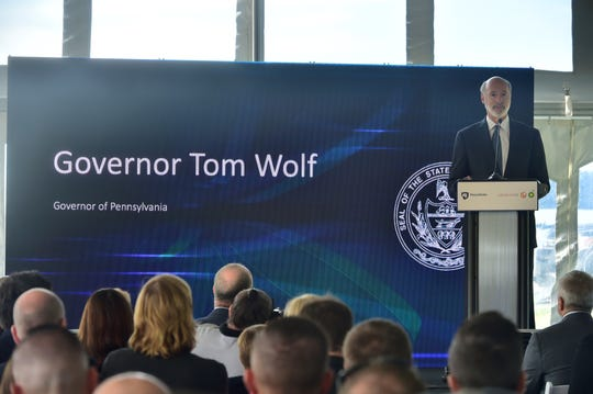 Gov. Tom Wolf speaks Friday, Sept. 6, 2019, at an event marking the groundbreaking on the largest solar project in Pennsylvania. A Newburg farm and two other locations in Franklin County will host 150,000 solar panels to power Penn State.