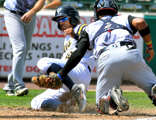 York Revolution's Alvaro Rondon is tagged out by Blue Crabs' catcher Charlie Valerio while trying to score from third on a foul fly ball during play at PeoplesBank Park Sunday, Sept. 8, 2019. The Revs won 5-1. Bill Kalina photo