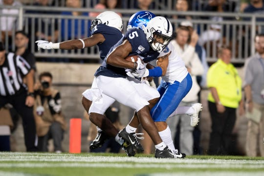 Penn State wide receiver Jahan Dotson (5) hauls in a touchdown pass in front of Buffalo cornerback Aapri Washington (3) in the first quarter of an NCAA college football game in State College, Pa., on Saturday, Sept. 7, 2019. (AP Photo/Barry Reeger)