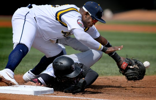 York Revolution first baseman Telvin Nash reaches for an errant throw during a double play attempt on Blue Crabs' runner Kent Blackstone who advanced to second during play at PeoplesBank Park Sunday, Sept. 8, 2019. The Revs won 5-1. Bill Kalina photo
