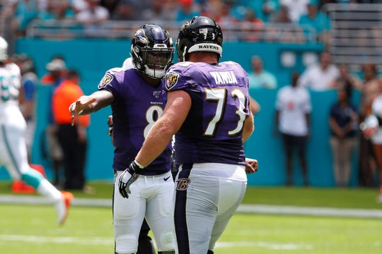 Baltimore Ravens quarterback Lamar Jackson (8) celebrates a touchdown with offensive guard Marshal Yanda (73), during the first half at an NFL football game against the Miami Dolphins, Sunday, Sept. 8, 2019, in Miami Gardens, Fla. (AP Photo/Wilfredo Lee)