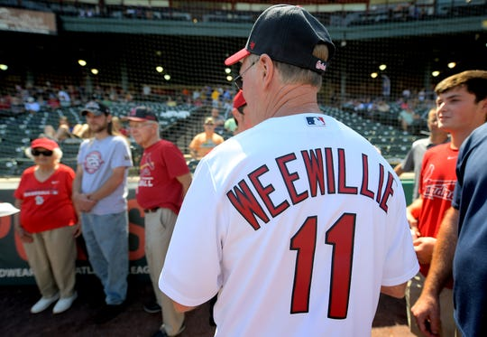 John Sherdel of New Oxford mingles with family members after throwing a ceremonial first pitch before the York Revolution game at PeoplesBank Park Sunday, Sept. 8, 2019. John's grandfather, Wee Willie Sherdel, was posthumously inducted into the York Area Sports Hall of Fame Sunday before the Revs' game. Wee Willie remains the Cardinals' winningest left-handed pitcher ever over a 15-year career that spanned from 1918 to 1932. John and other members of the family, wearing Cardinals' jerseys, were at the game for the presentation. Bill Kalina photo