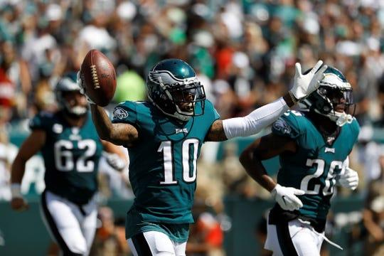 Philadelphia Eagles' DeSean Jackson celebrates after scoring touchdown during the first half of an NFL football game against the Washington Redskins, Sunday, Sept. 8, 2019, in Philadelphia. (AP Photo/Michael Perez)