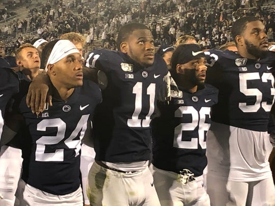 Micah Parsons (11) was force in the Nittany Lions' second-half surge over Buffalo. He had 10 tackles, two for loss. Then he lead the singing of the alma mater.