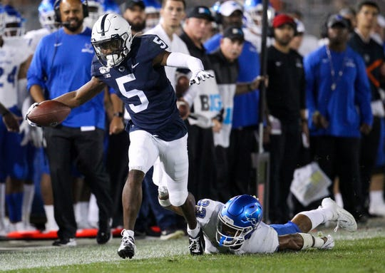 Sep 7, 2019; University Park, PA, USA; Penn State Nittany Lions wide receiver Jahan Dotson (5) runs with the ball past Buffalo Bulls safety Tyrone Hill (33) during the third quarter at Beaver Stadium. Penn State defeated Buffalo 45-13. Matthew O'Haren-USA TODAY Sports