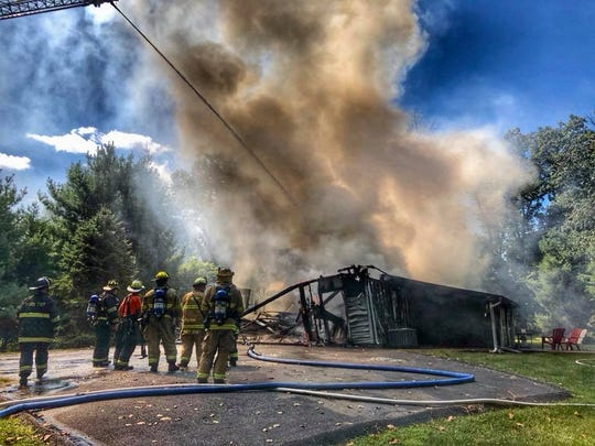 Firefighters from Goodwill Fire Co. No. 1 and Yoe Fire Co.,  help put out a house fire along the 900 block of Aspen Lane in York Township on Saturday, Sept. 7, 2019.