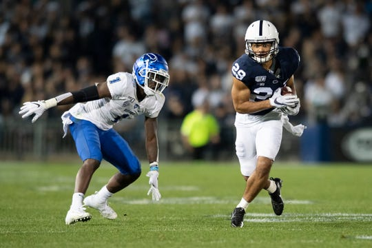 Penn State cornerback John Reid (29) intercepts a pass in front of Buffalo wide receiver Antonio Nunn (1) and reruns it for a touchdown during the third quarter Saturday.