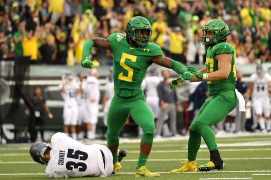Oregon's Kayvon Thibodeaux (5) reacts after making a tackle on Nevada punter Quinton Conaway during the Ducks' second-quarter surge.