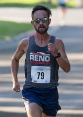 Lupe Cabada heads to the finish line as he wins the 51st Annual Journal Jog at Idlewild Park in Reno on Sunday.
