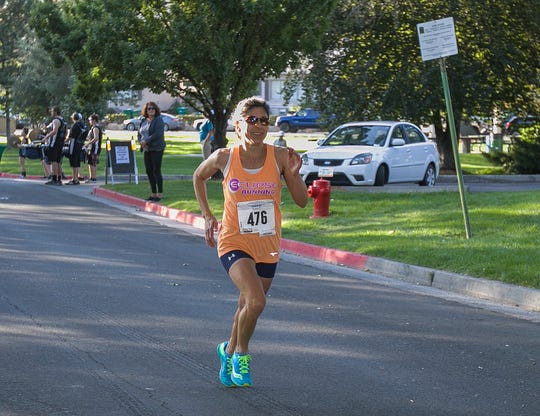 Ramona Sanchez heads to the finish line during the 51st Annual Journal Jog at Idlewild Park in Reno on Sunday.