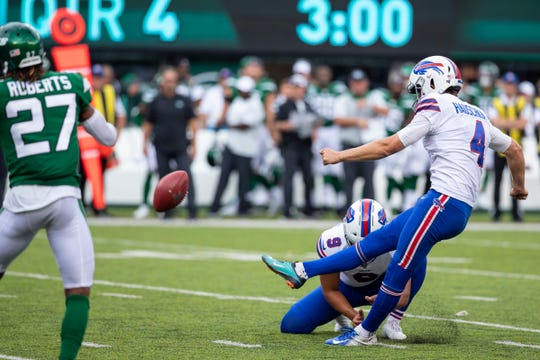 EAST RUTHERFORD, NJ - SEPTEMBER 08:  Stephen Hauschka #4 of the Buffalo Bills kicks what would be the winning point after a touchdown in the fourth quarter against the New York Jets at MetLife Stadium on September 8, 2019 in East Rutherford, New Jersey. Buffalo defeats New York 17-16.  (Photo by Brett Carlsen/Getty Images)