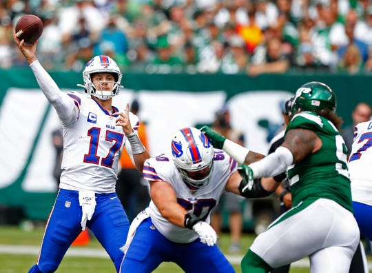 Buffalo Bills quarterback Josh Allen (17) passes against the New York Jets during the second half at MetLife Stadium. Mandatory Credit: Noah K. Murray-USA TODAY Sports