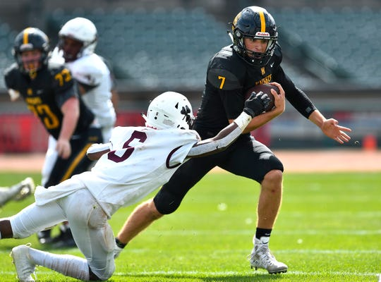 McQuaid's Joe Cairns, right, is tackled by Aquinas' Zachary Kelsey during the season opener played at Frontier Field, Saturday, Sept. 7, 2019. McQuaid's 27-21 win snaps a 15-game losing streak to Aquinas and returns the annual Challenge Trophy to McQuaid.