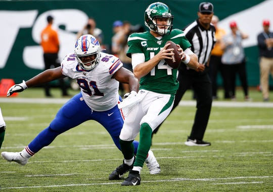 Sam Darnold of the New York Jets evades Ed Oliver(91) of the Buffalo Bills during their game at MetLife Stadium on September 8, 2019 in East Rutherford, New Jersey.