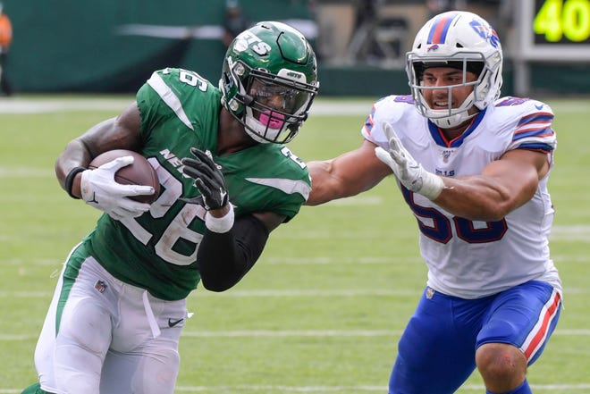 Buffalo Bills' Matt Milano (58) forces New York Jets' Le'Veon Bell (26) out of bounds during the second half of an NFL football game Sunday, Sept. 8, 2019, in East Rutherford, N.J. (AP Photo/Bill Kostroun)
